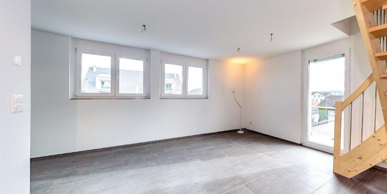 Mietwohnung-Dach-links-Salmsach-Wohnzimmer